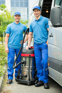 Two Male Cleaners With Vacuum Cleanerの写真素材 [FYI00767868]