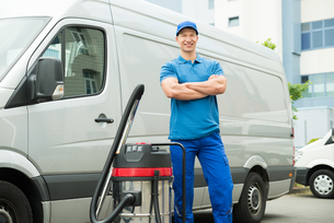 Cleaner Standing With Vacuum Cleanerの写真素材 [FYI00768138]