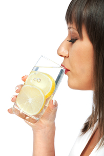Woman drinking water with lemon,Woman drinking water with lemon,Woman drinking water with lemon,Woman drinking water with lemon,Woman drinking water with lemon,Woman drinking water with lemon,Woman drinking water with lemon,Woman drinking water with lemonの素材 [FYI00768489]