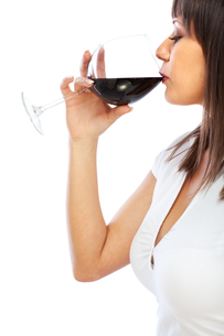 Young woman drinking red wineの写真素材 [FYI00768490]