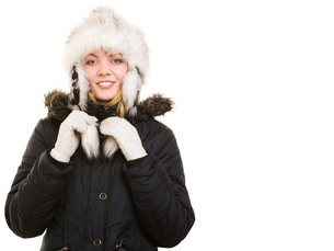winter vacation. cheerful girl in warm clothes.の写真素材 [FYI00768532]