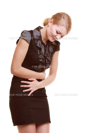 indigestion. woman suffering from stomach pain isolated.の写真素材 [FYI00768666]