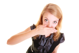 buisnesswoman surprised woman covers her mouth isolatedの写真素材 [FYI00768672]