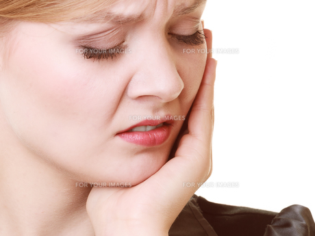 toothache. young woman suffering from tooth pain isolatedの素材 [FYI00768681]