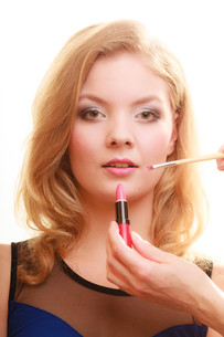 makeup. woman applying red lipstick with brushの写真素材 [FYI00768688]