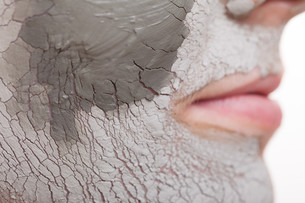 skin care. woman applying clay mask on face. spa.の写真素材 [FYI00768961]