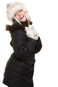 winter vacation. cheerful girl in warm clothes.の写真素材 [FYI00768997]
