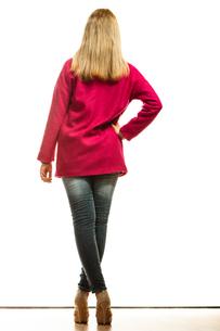 fashionable blonde woman in vivid color coat.の写真素材 [FYI00769071]