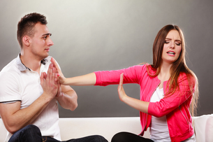 husband apologizing wife. angry upset woman.の写真素材 [FYI00769120]