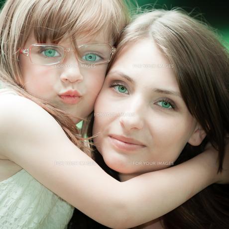 little girl hugging his mother expressing tender feelings. love.の素材 [FYI00769353]