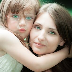 little girl hugging his mother expressing tender feelings. love.の写真素材 [FYI00769353]