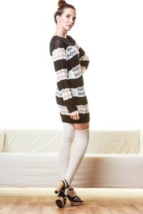girl fashionable dress high heels posingの素材 [FYI00769787]