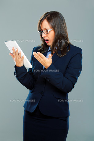 Businesswoman holding tablet,Businesswoman holding tablet,Businesswoman holding tablet,Businesswoman holding tabletの素材 [FYI00770264]