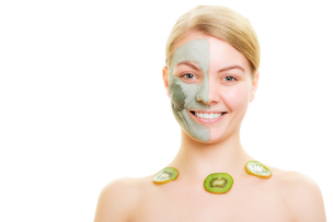 skin care. woman in clay mask with kiwi on faceの写真素材 [FYI00770482]