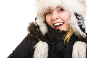 winter vacation. cheerful girl in warm clothes.の写真素材 [FYI00770514]