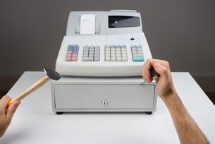 Person Hands With Worktool And Cash Registerの写真素材 [FYI00770571]