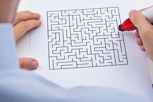 Person With Maze On Paperの写真素材 [FYI00770607]