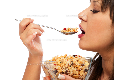 Young woman eating cereal breakfast,Young woman eating cereal breakfast,Young woman eating cereal breakfast,Young woman eating cereal breakfastの素材 [FYI00770887]