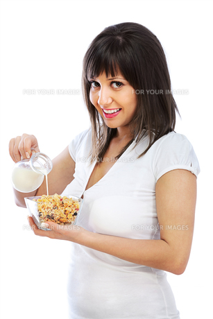 Young woman eating cereal breakfast,Young woman eating cereal breakfast,Young woman eating cereal breakfast,Young woman eating cereal breakfastの素材 [FYI00770899]