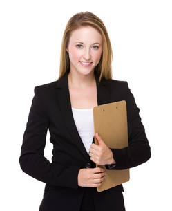 Young caucasian Businesswoman hold with clipboardの写真素材 [FYI00771567]