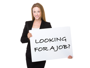 Businesswoman holding with a placard showing phrase of looking for a jobの写真素材 [FYI00771585]