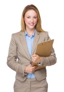 Caucasian businesswoman with clipboardの写真素材 [FYI00771593]