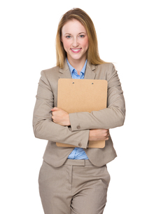 Caucasian businesswoman hold with clipboardの写真素材 [FYI00771633]