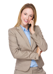 Caucasian businesswoman talk to mobile phoneの写真素材 [FYI00771649]