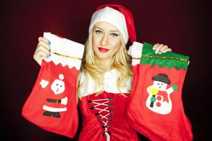 Christmas girl with Christmas stockingsの写真素材 [FYI00771983]