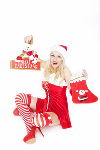 Sexy Christmas girl with Christmas stocking and decorationの写真素材 [FYI00771990]