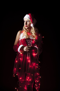 Sexy Christmas girl covered in Christmas lightsの写真素材 [FYI00772003]