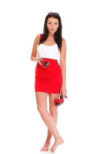 portrait of a sexy brunette in red white dress isolatedの写真素材 [FYI00772397]