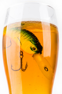 fishing bait wobbler in glass with beerの写真素材 [FYI00772424]