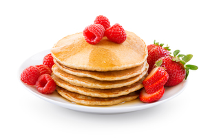 Plate full of pancakes with berries over white backgroundの写真素材 [FYI00772425]