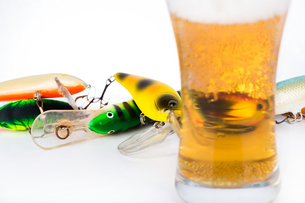 fishing bait wobblers near glass with beerの写真素材 [FYI00772455]