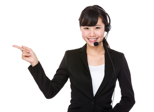 Call center operator with finger point upの写真素材 [FYI00772588]
