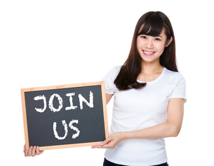 Woman hold with chalkboard showing phrase of join usの素材 [FYI00772596]