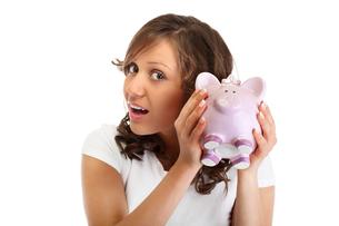 Woman holding pig money-box,Woman holding pig money-box,Woman holding pig money-box,Woman holding pig money-boxの写真素材 [FYI00773251]