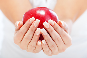 Young woman holding red apple,Young woman holding red apple,Young woman holding red apple,Young woman holding red apple,Young woman holding red apple,Young woman holding red apple,Young woman holding red apple,Young woman holding red appleの素材 [FYI00773269]