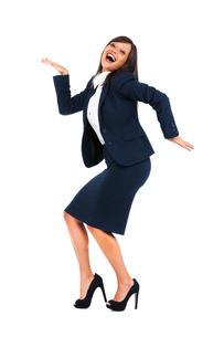 Excited businesswoman dancing,Excited businesswoman dancingの写真素材 [FYI00773280]