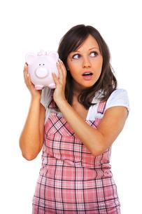 Woman holding pig money-box,Woman holding pig money-box,Woman holding pig money-box,Woman holding pig money-boxの写真素材 [FYI00773303]
