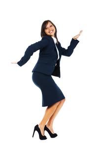 Excited businesswoman dancing,Excited businesswoman dancingの写真素材 [FYI00773308]