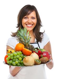 Young woman with fruits,Young woman with fruits,Young woman with fruits,Young woman with fruitsの写真素材 [FYI00773317]