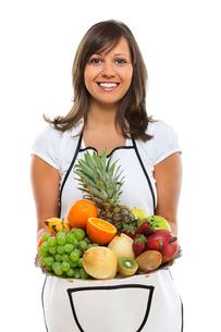 Young woman with fruits,Young woman with fruits,Young woman with fruits,Young woman with fruitsの写真素材 [FYI00773537]