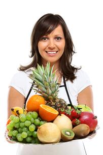 Young woman with fruits,Young woman with fruits,Young woman with fruits,Young woman with fruitsの写真素材 [FYI00773574]