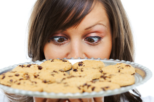 Young woman with homemade cookiesの写真素材 [FYI00773710]