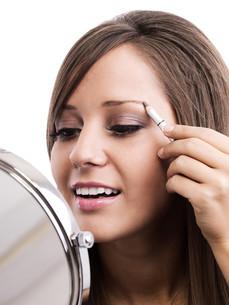 Applying make-up,Applying make-up,Applying make-up,Applying make-upの素材 [FYI00773840]