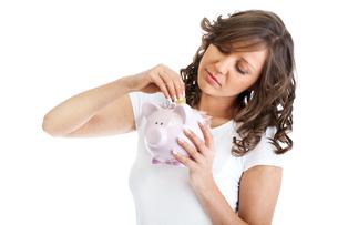 Woman holding pig money-box,Woman holding pig money-box,Woman holding pig money-box,Woman holding pig money-boxの写真素材 [FYI00773878]