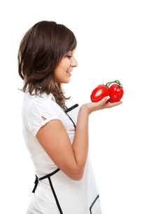 Young woman with tomatosの写真素材 [FYI00773939]