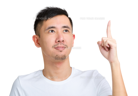 Man with finger point up and look away from cameraの写真素材 [FYI00774403]
